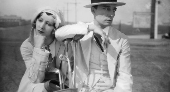 17th March 1931: Buster Keaton (1895 - 1966) and Charlotte Greenwood (1890 - 1978) guard their golf clubs in the comedy 'Parlor, Bedroom and Bath', directed by Edward Sedgwick. The film is alternatively titled 'Romeo in Pyjamas'.